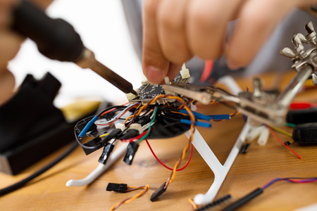 Welding wire of electronic parts drone Stock Photo