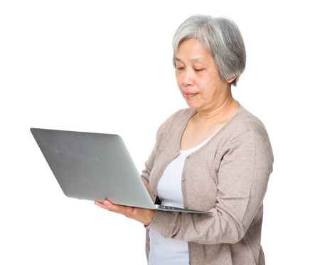 computer use: Elderly woman use of laptop computer Stock Photo