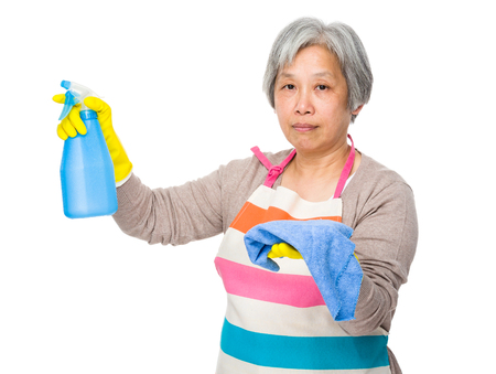 japanese cookery: Elderly housewife hold with bottle spray and rag