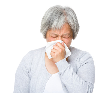 Mature woman runny nose photo