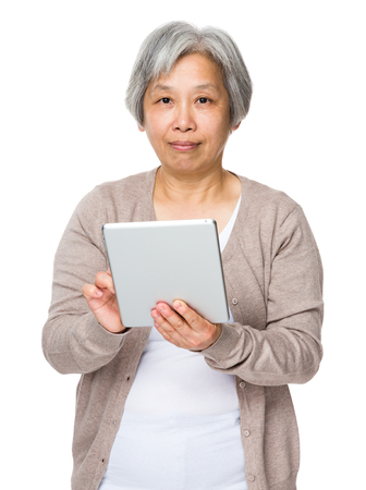 Old woman use of tablet photo