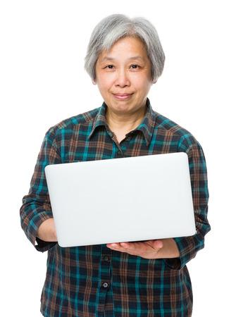 Old woman enjoys computer photo