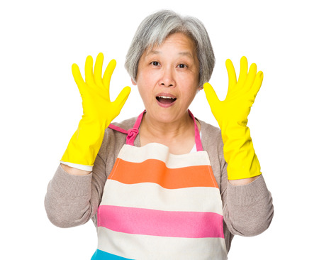 Excite housewife with plastic gloves and raise hand up photo