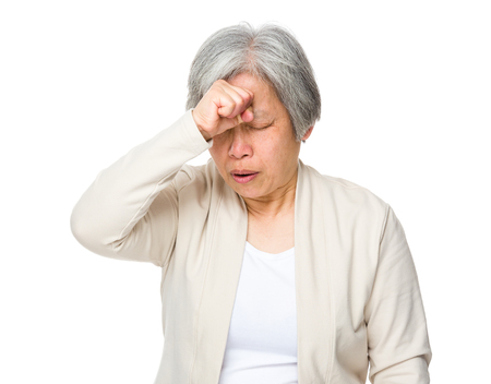 Retired woman feeling headache photo