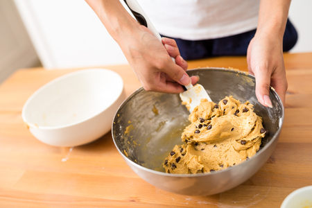 sift: Stirring the paste in bowl Stock Photo