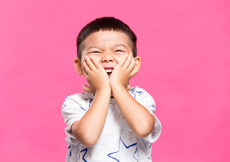 thrill: Excited little boy Stock Photo