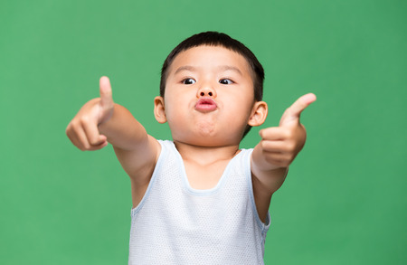 Little boy showing thumb up gesture Standard-Bild