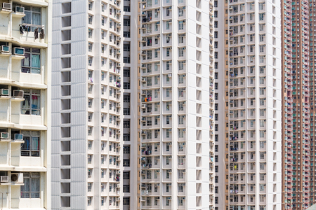 overpopulated: Downtown residential building facade