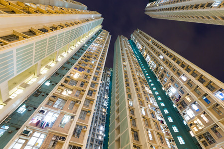 overpopulated: Residential building in Hong Kong at night