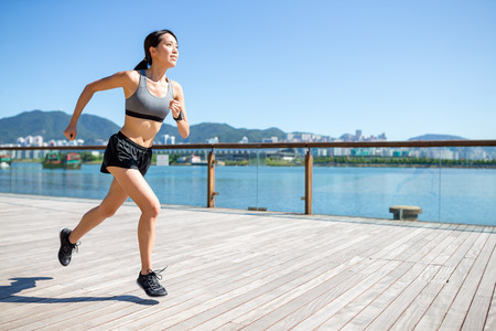 Woman jogging in a city 写真素材