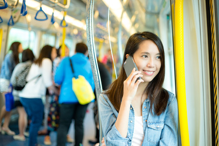 transposition: Woman talk to cellphone in train compartment