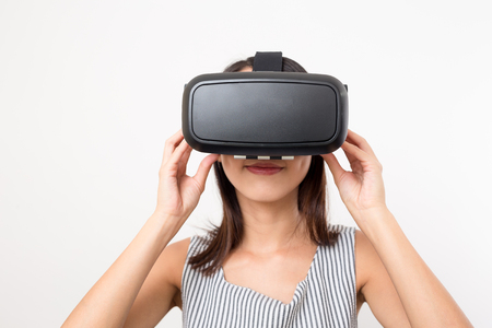though: Young woman looking though VR