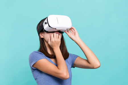 frighten: Woman watching though VR device and feeling frighten Stock Photo