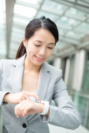 Young business woman use of smart watch