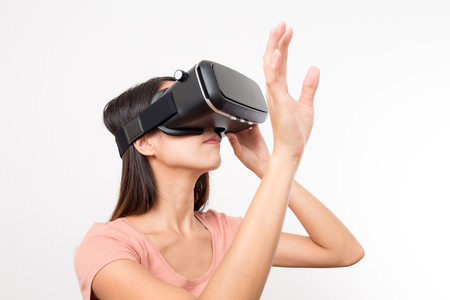 though: Young Woman looking though virtual reality Stock Photo