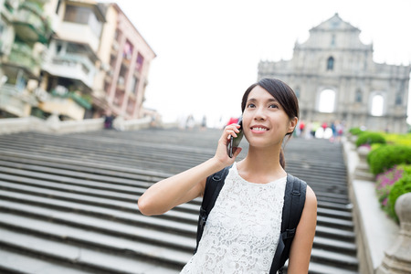 woman on phone: Woman talking to phone