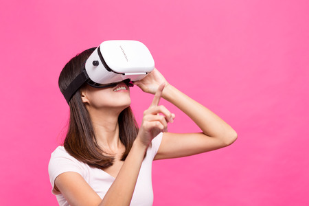 though: Asian Woman experience though virtual reality device