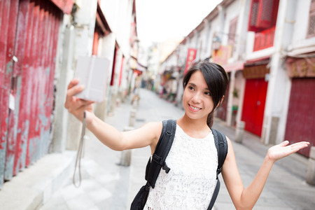 self image: Young Woman taking self image by digital camera in Macao