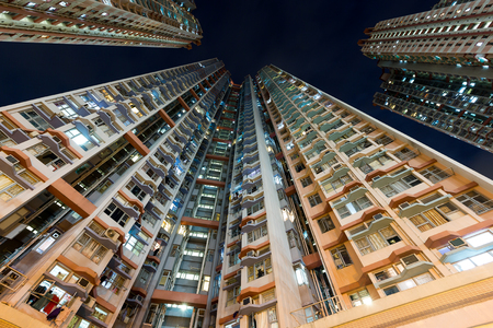 overpopulated: Residential building from low angle Stock Photo