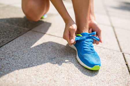 shoestrings: Woman trying shoelace