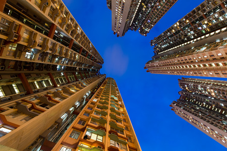 overpopulated: Apartment building from low angle