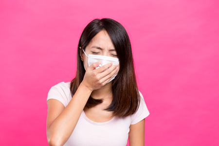 transmissible: Asian Woman wearing face mask and want to vomit Stock Photo