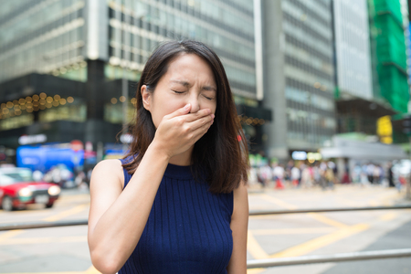 respiration: Woman feeling sick at outdoor
