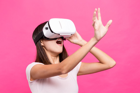terrifying: Asian Woman looking though virtual reality device