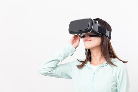 Asian woman experience though VR glasses Foto de archivo