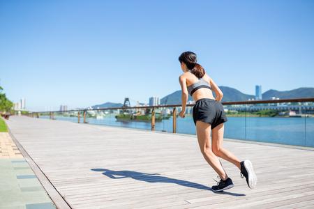 Woman run at outdoor Stock Photo