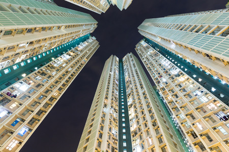 overpopulated: Apartment building to the sky at night