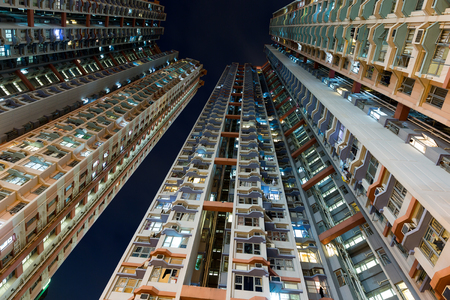 overpopulated: Skyscraper from low angle at night