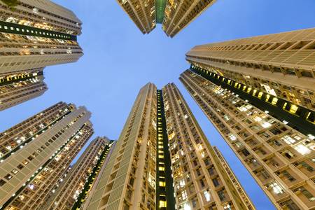 overpopulated: Resident apartment building from low angle