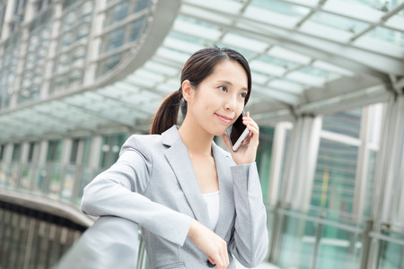 hear business call: Business woman talk to mobile phone