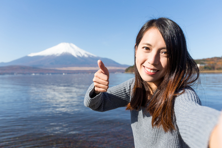 Woman taking photo with Mt. Fuji Stock Photo