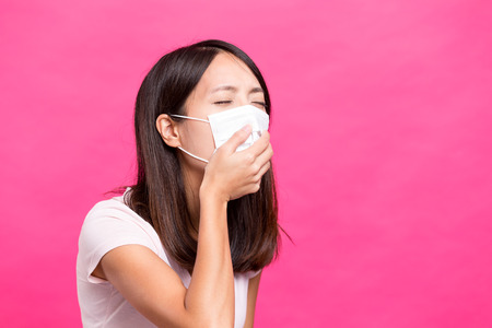 transmissible: Woman wearing face mask and want to vomit