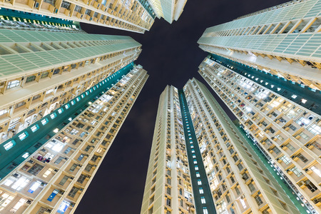 overpopulated: Residential building to the sky at night