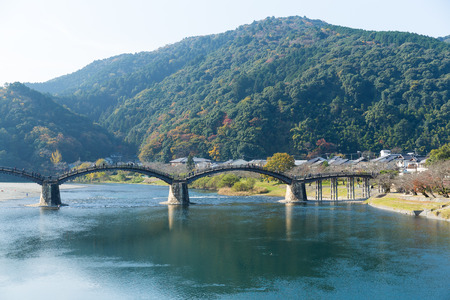Wooden arched bridge in Japan Stock Photo