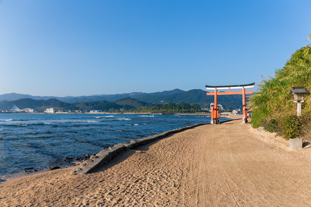 Aoshima Island and japanese torii with sunshine