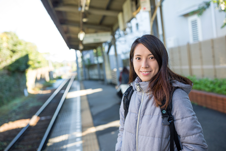 Woman waiting train in platform Stock Photo
