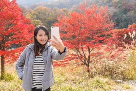 Woman taking photo by cellphone Stock Photo