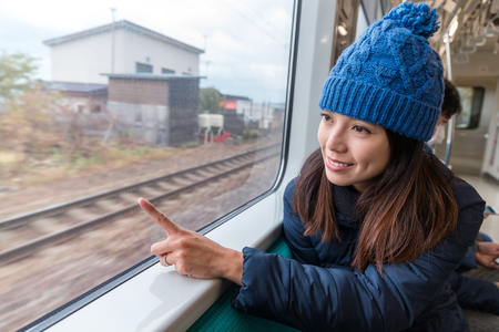 Woman travel by train Banco de Imagens