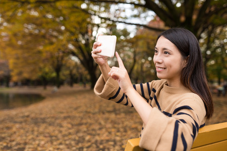 Young woman taking photo by cellphone Stock Photo