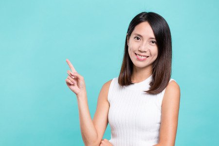 Woman showing finger pointing up Stock Photo