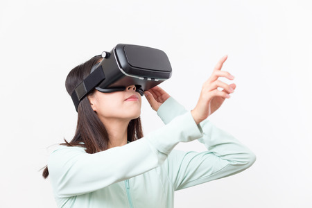 Woman using VR device and finger pointing up Stock Photo