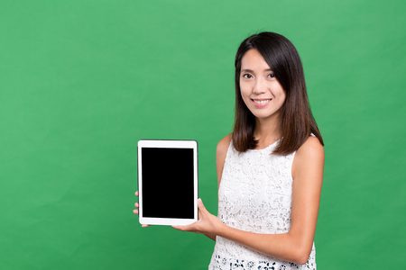 blank tablet: Woman showing the blank screen of digital tablet computer Stock Photo