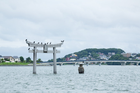 Stone torii with water in Fukuoka city Stock Photo