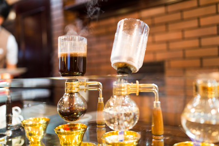 siphon: Siphon vacuum coffee maker on cafe bar Stock Photo