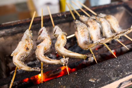 Grilled fish at street Stock Photo