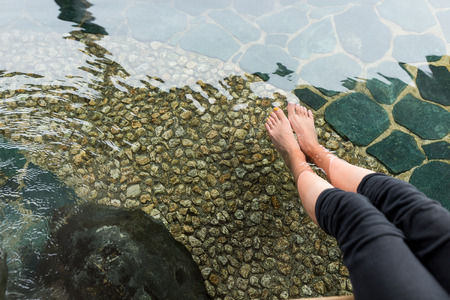 Woman having onsen on legs